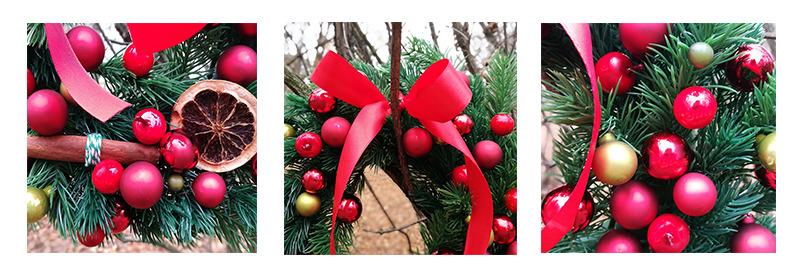 czerwone detale na wianku bożonarodzeniowym