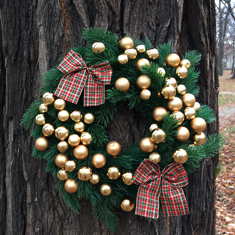wianek bożonarodzeniowy złote bombki z kokardami